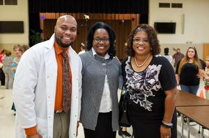 Mr. Brandon C Parker, Dr. Michelle Claville and Ms. Levia Mason Stovall
